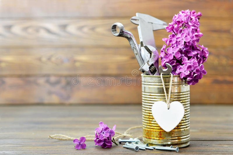 Fathers Day card with tools, heart and lilac flowers royalty free stock photo