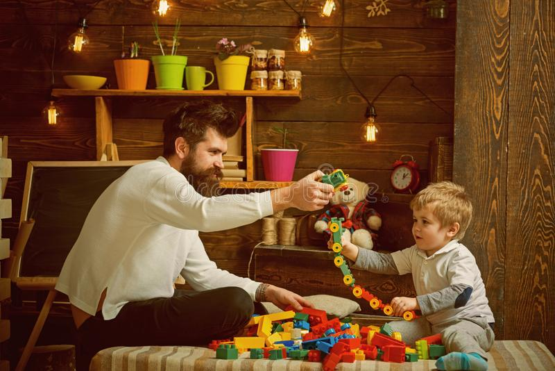 Fathers day concept. Father and baby son play with toys on fathers day. I have fathers day everyday. Happy fathers day. My dad is my best mate royalty free stock image