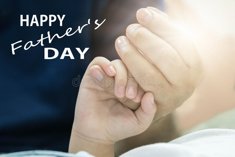 Fathers day concept, father and son hold hands with love. Fathers day concept, father and son hold hands with love stock image