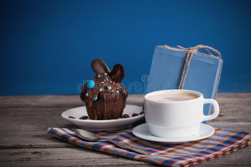 Fathers Day cupcake gift and cup of coffee stock photo