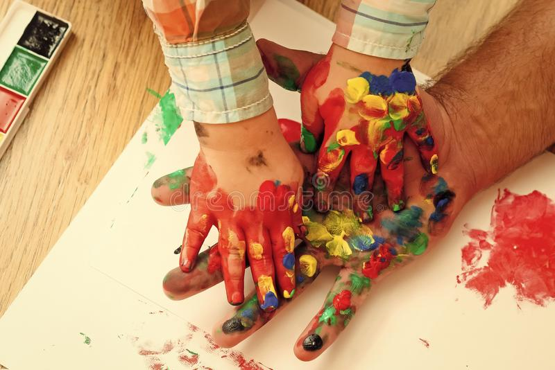 Fathers day, family love and care. Imagination, creativity and freedom. Kids playing - happy game. Handprint painting. Concept. Hands and fingers drawing with royalty free stock images