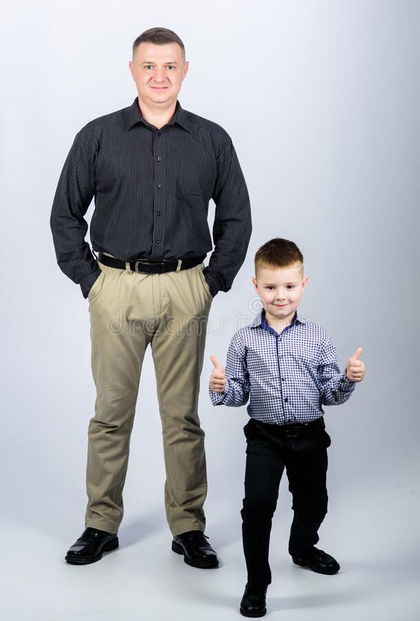 Fathers day. Father example of noble human. Family support. Family bonds. Trustful relations father and son. Enjoying. Fatherhood. Father and cheerful little stock photography
