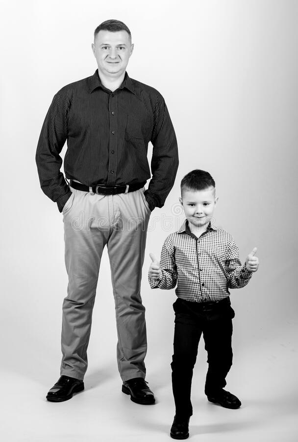 Fathers day. Father example of noble human. Family support. Family bonds. Trustful relations father and son. Enjoying. Fatherhood. Father and cheerful little royalty free stock photos