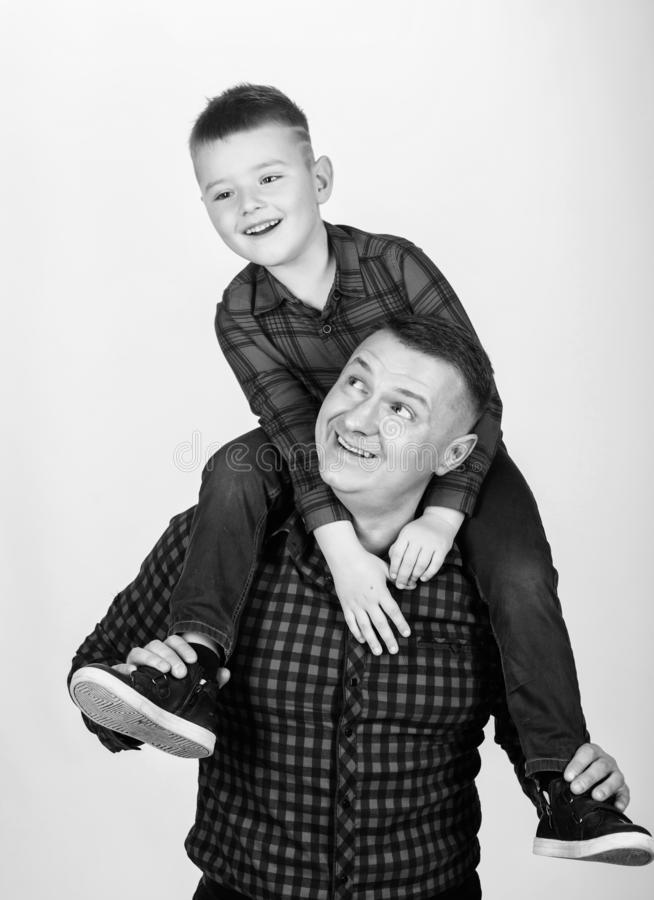 Fathers day. Father example of noble human. Father little son red shirts family look outfit. Best friends forever. Dad. Piggybacking adorable child. Having fun royalty free stock photos