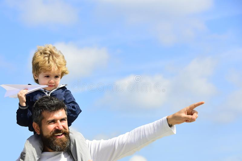 Fathers day. Father giving son ride on back in park. Funny time. Fathers day. Father giving son ride on back in park. Funny time royalty free stock image
