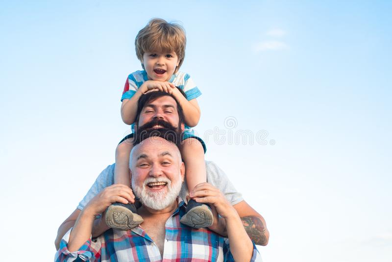 Fathers day. Father and son with grandfather - Men generation. Fathers day. Father and son with grandfather - Men generation stock photos