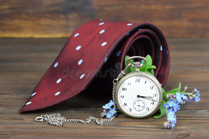 Fathers Day gift. Fathers Day tie, flowers and vintage pocket wa royalty free stock photography