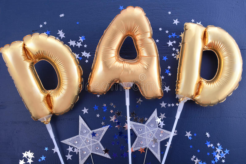 Fathers Day gold Dad balloons. stock image