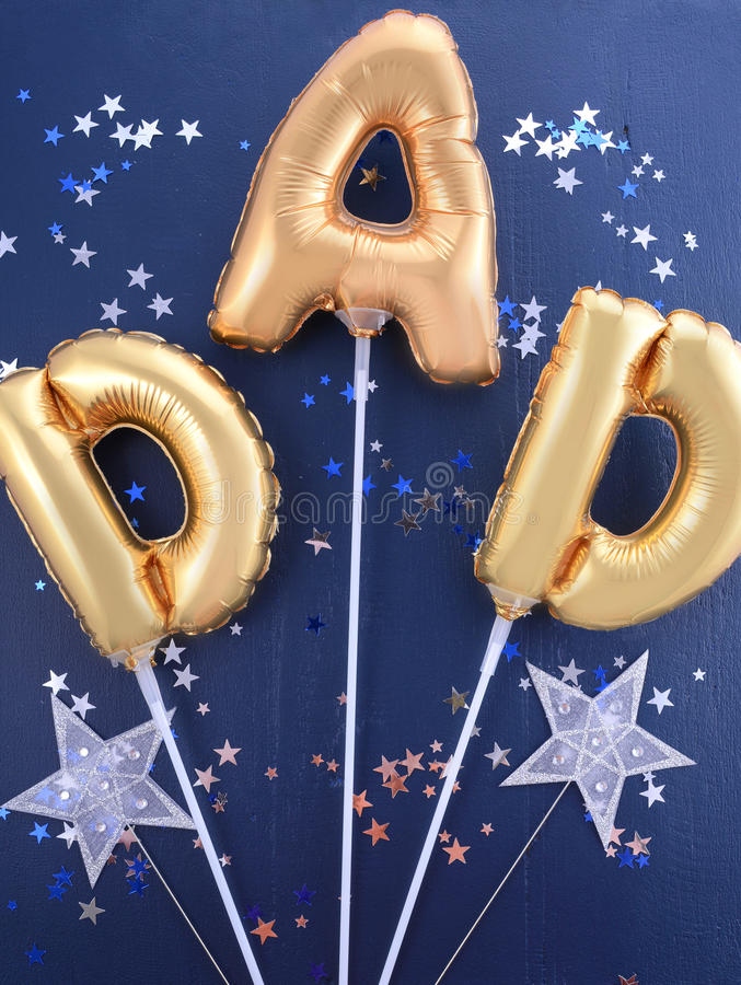 Fathers Day gold Dad balloons. royalty free stock image