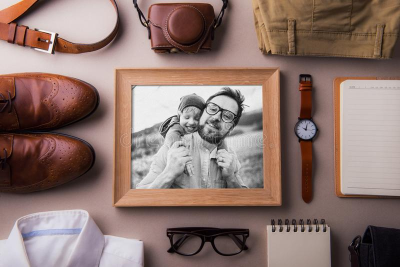 Fathers day greeting card concept. A photo of a dad and toddler son. Flat lay. royalty free stock image