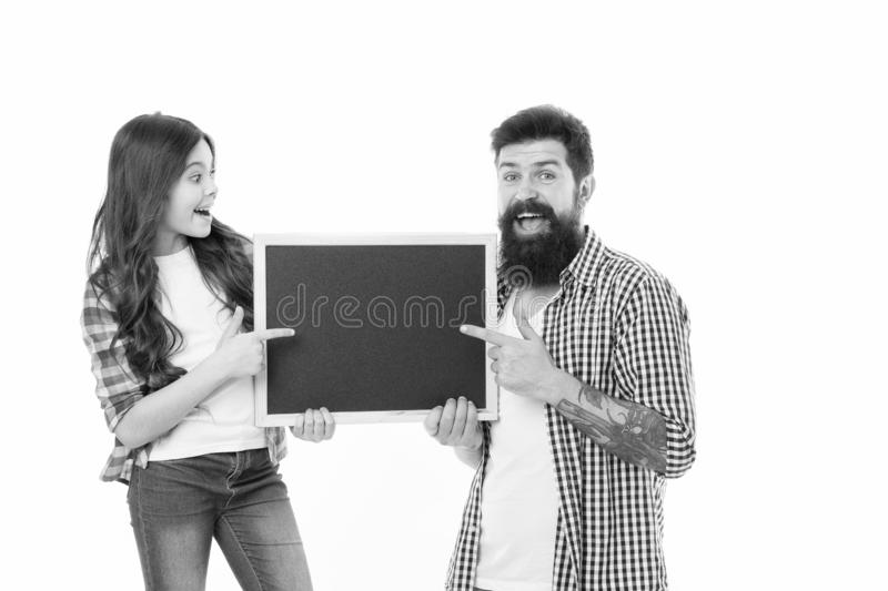 Fathers day. Happy family. father with daughter. Little girl love her father. Family day. Little girl pointing on school. Blackboard. Father and daughter hold stock photos