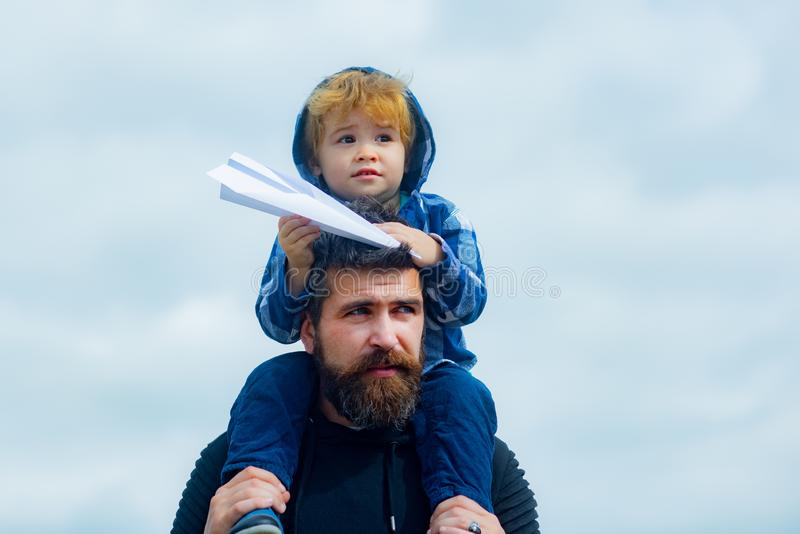 Fathers day. Happy father giving son back ride on sky in summer. Family Time. Dream of flying. Fathers day. Happy father giving son back ride on sky in summer royalty free stock images