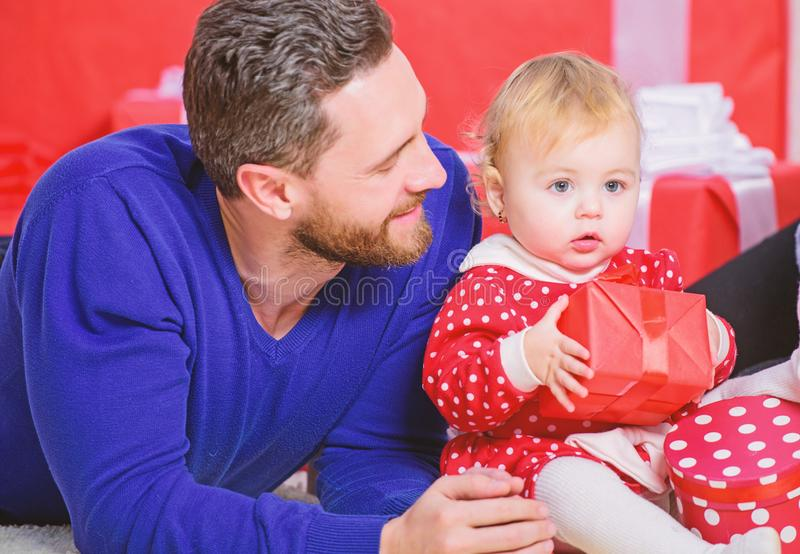 Fathers day holiday. Shopping online. Boxing day. Love and trust in family. Bearded man with little girl. Happy family. With present box. father and doughter royalty free stock photography