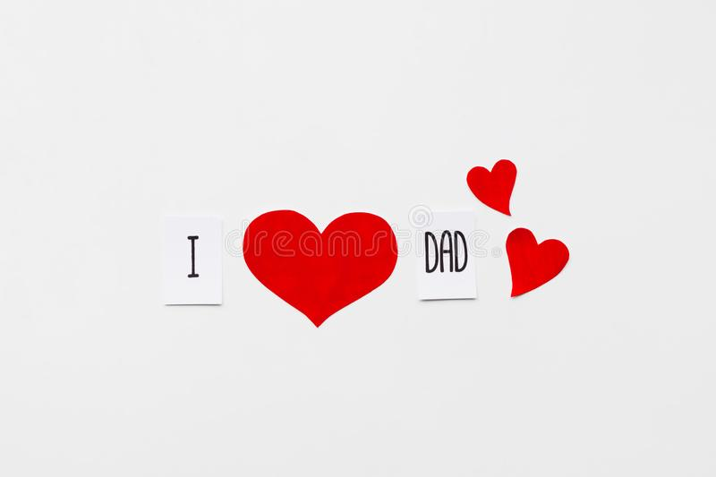 Fathers day. Message with red paper hearts on white background. Top view. Birthday stock images