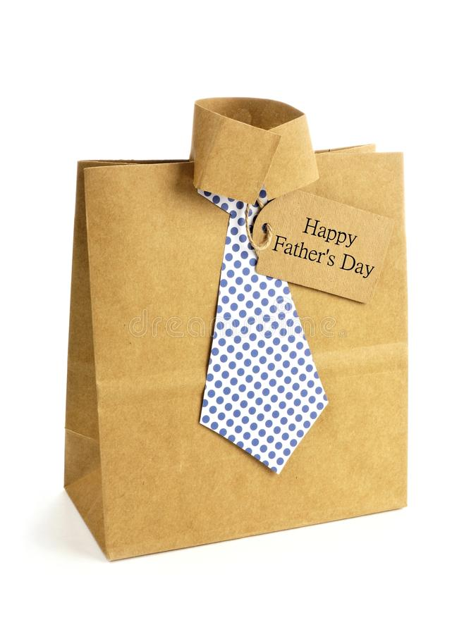 Fathers Day shirt and tie gift bag. Fathers Day handmade shirt and tie gift bag with greeting card on a white background royalty free stock images