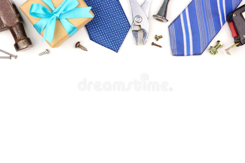 Fathers Day top border of gifts, ties and decor isolated on white royalty free stock photos