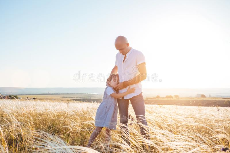 Fathrer and cute daughter playing like airplane royalty free stock photos