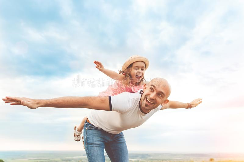 Fathrer and cute daughter playing like airplane stock image