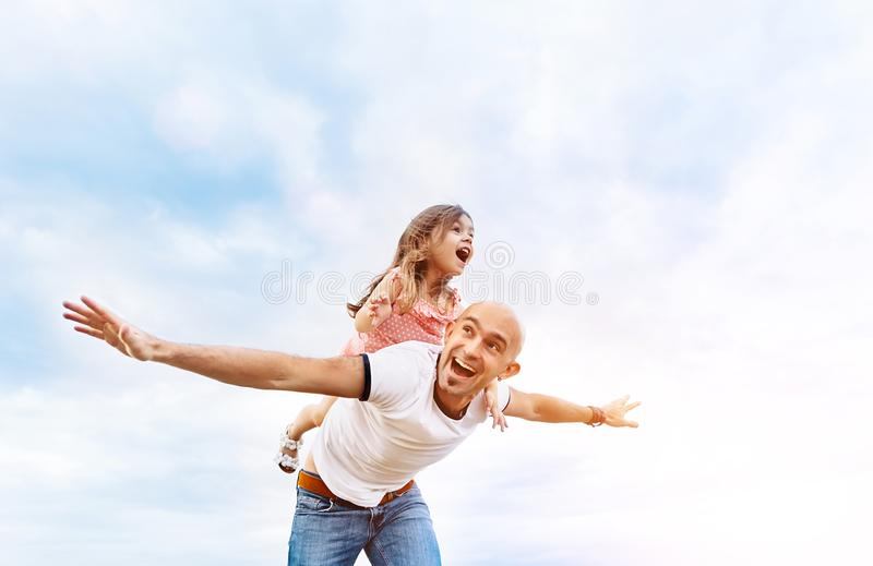 Fathrer and cute daughter playing like airplane stock photography