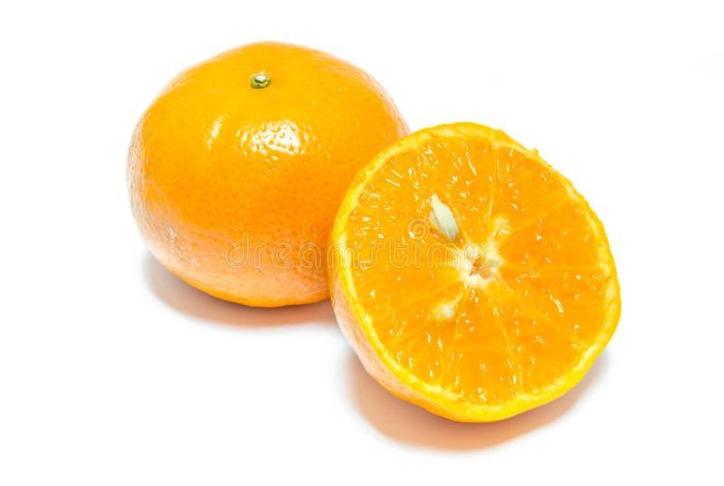 Fatia alaranjada do fruto no fundo branco fotos de stock royalty free