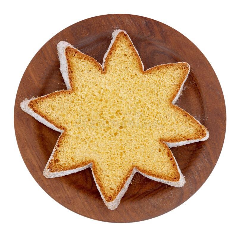 Fatia da forma da estrela de pandoro, pão de fermento doce italiano, deleite tradicional do Natal Vista colocada lisa aérea isola foto de stock