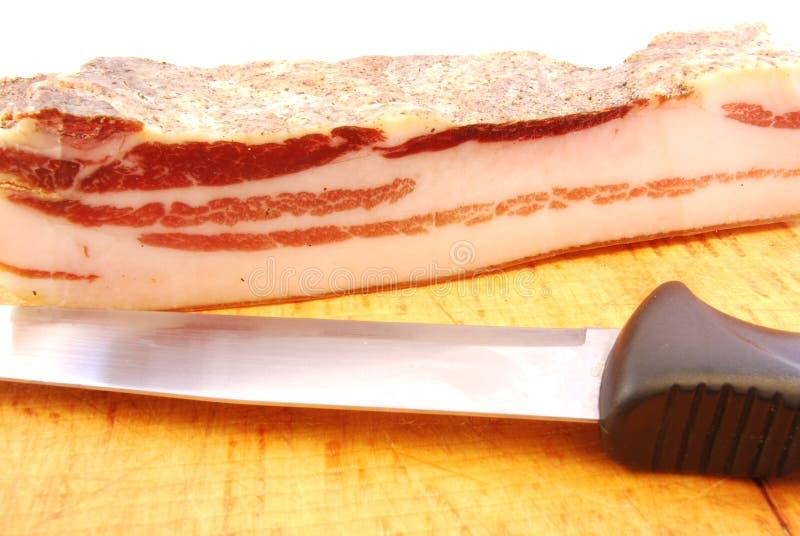 Fatia de bacon imagem de stock