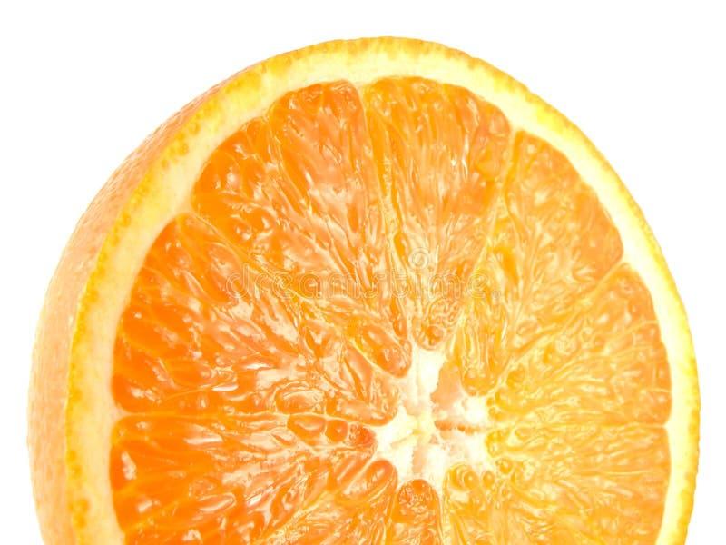 Fatia de meia laranja madura isolada no branco fotografia de stock
