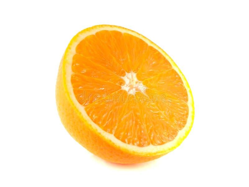 Fatia de meia laranja madura no branco fotografia de stock royalty free