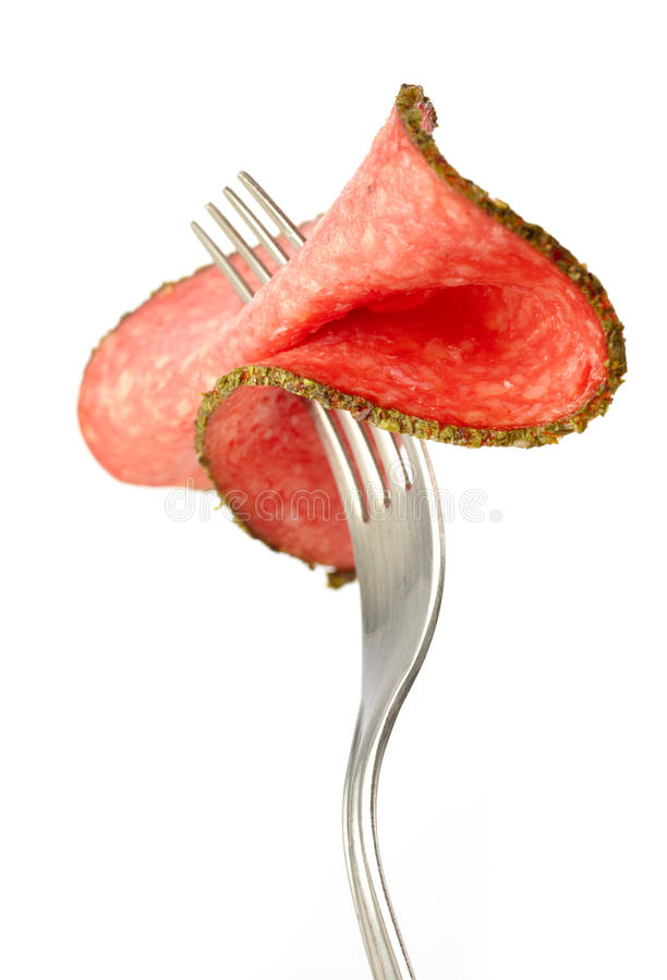 Fatia de salsicha do salami foto de stock royalty free