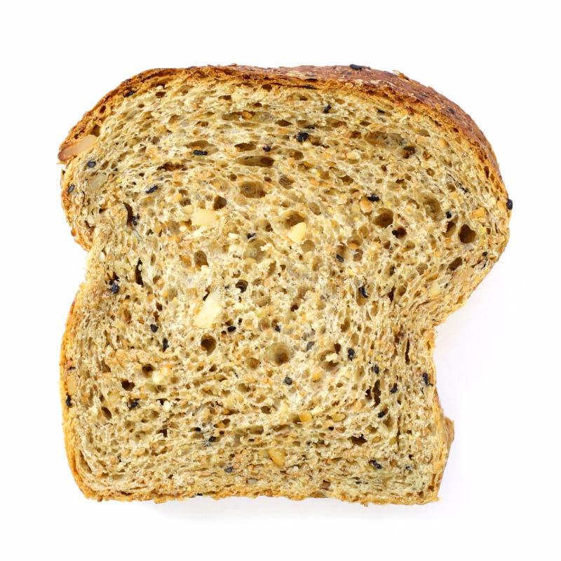 Fatia de um pão integral inteiro isolado imagens de stock