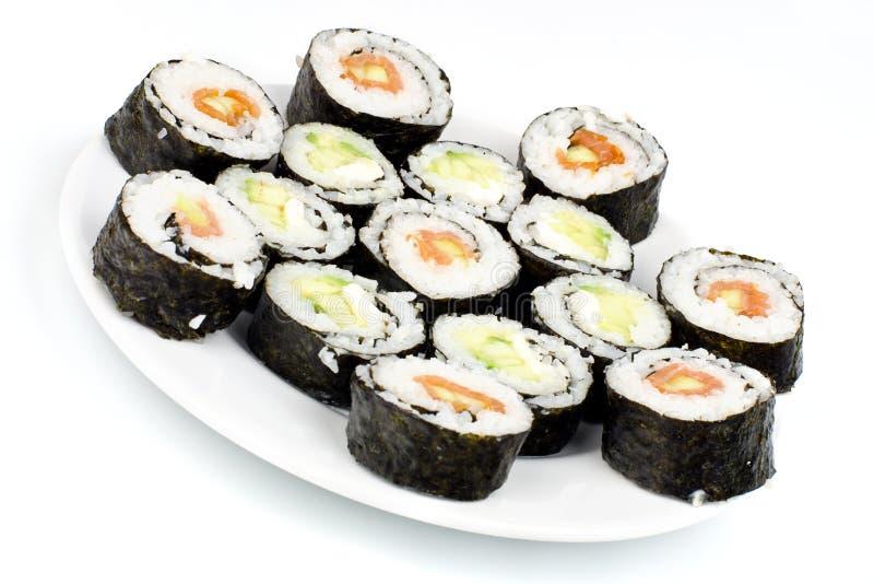 Fatias caseiros do sushi na placa fotografia de stock royalty free