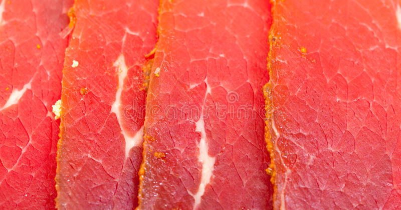 Fatias de carne fumado imagens de stock royalty free