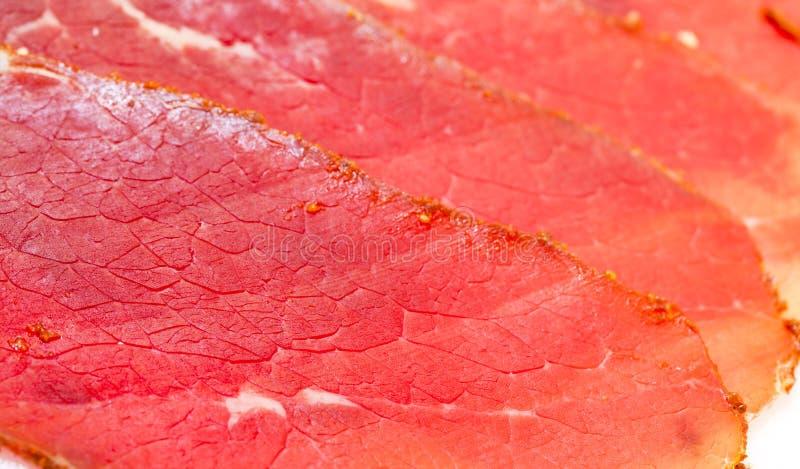 Fatias de carne fumado fotografia de stock royalty free