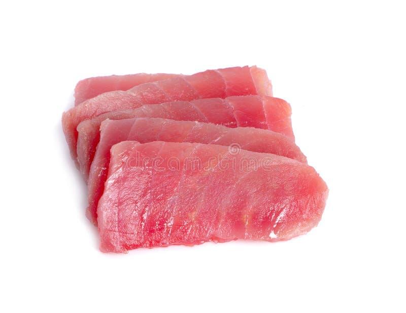 Fatias de carne de peixes crua do atum no fundo branco imagens de stock royalty free
