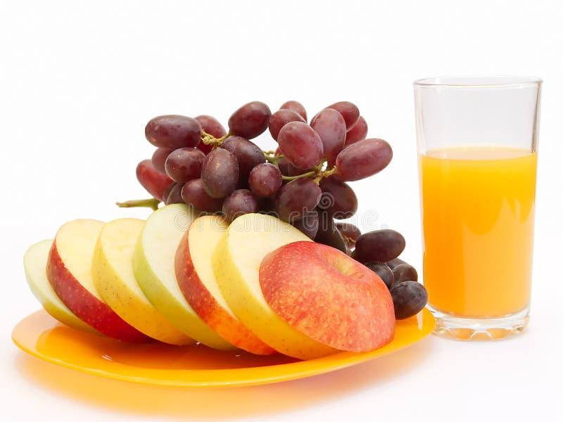 Fatias de fruta e de suco fotografia de stock royalty free