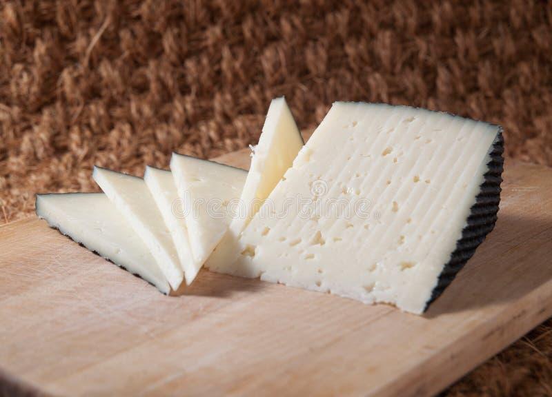 Fatias de queijo espanhol imagens de stock