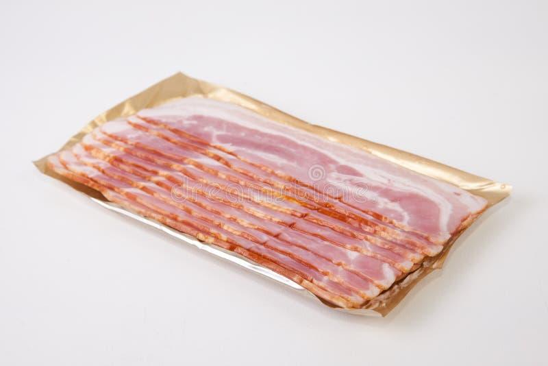 Fatias do bacon no pacote imagens de stock