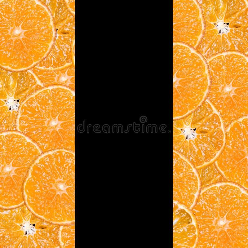 Fatias do fruto em um fundo preto foto de stock royalty free