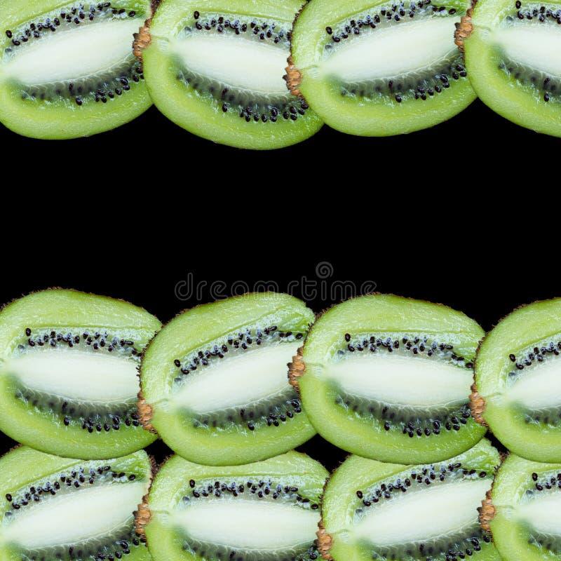 Fatias do fruto em um fundo preto fotos de stock
