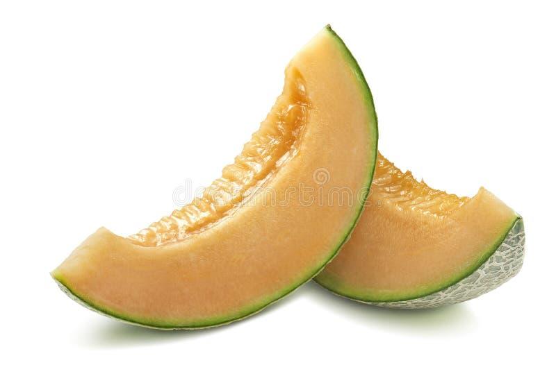 Fatias do melão do cantalupo isoladas no fundo branco foto de stock