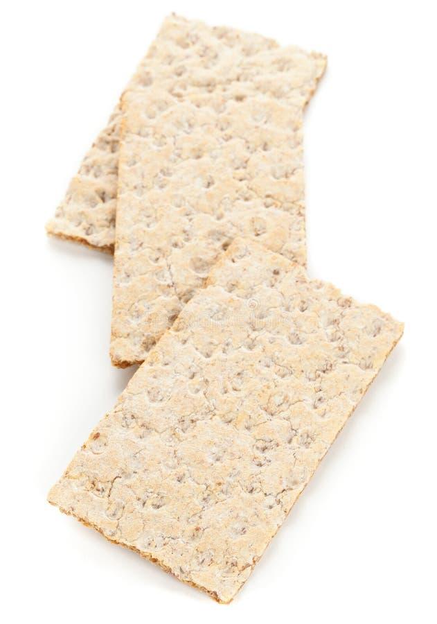 Fatias do pão estaladiço do trigo fotografia de stock
