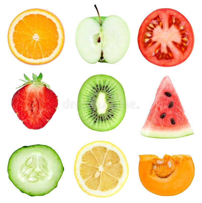 Fatias frescas das frutas e legumes imagem de stock