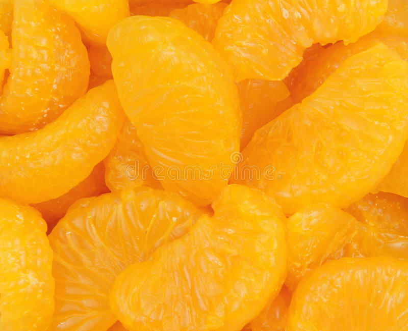 Fatias próximas do mandarino da vista imagem de stock royalty free