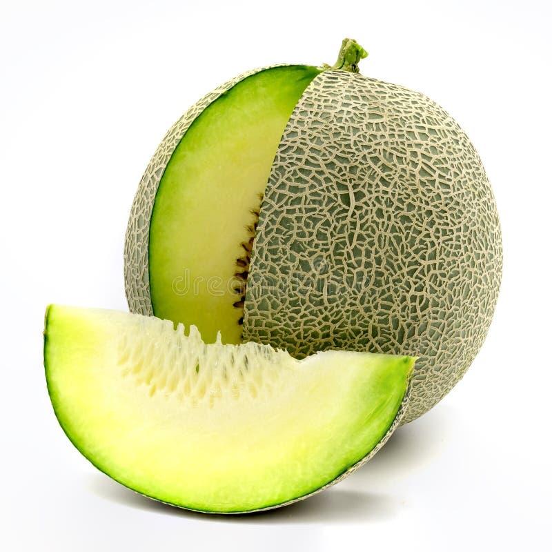 Fatias verdes do melão isoladas no fundo branco fotos de stock royalty free