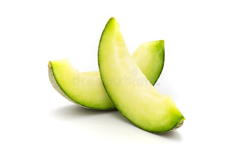 Fatias verdes do melão isoladas no fundo branco foto de stock royalty free