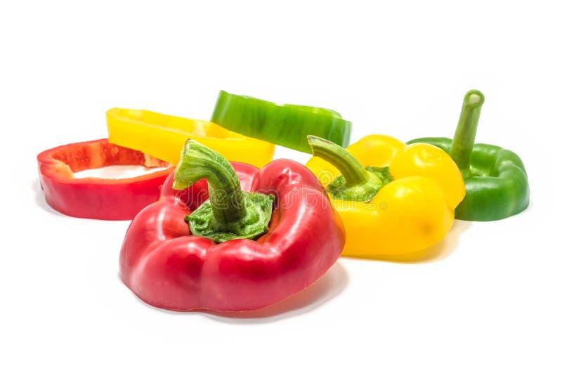 Fatias verdes e amarelas vermelhas de pimenta de sino imagem de stock
