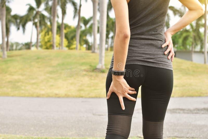 Fatigue de muscle des coureurs images stock