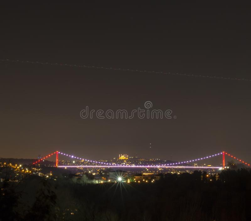 Fatih Sultan Mehmet bridge and Camlica Mosque night time view royalty free stock images