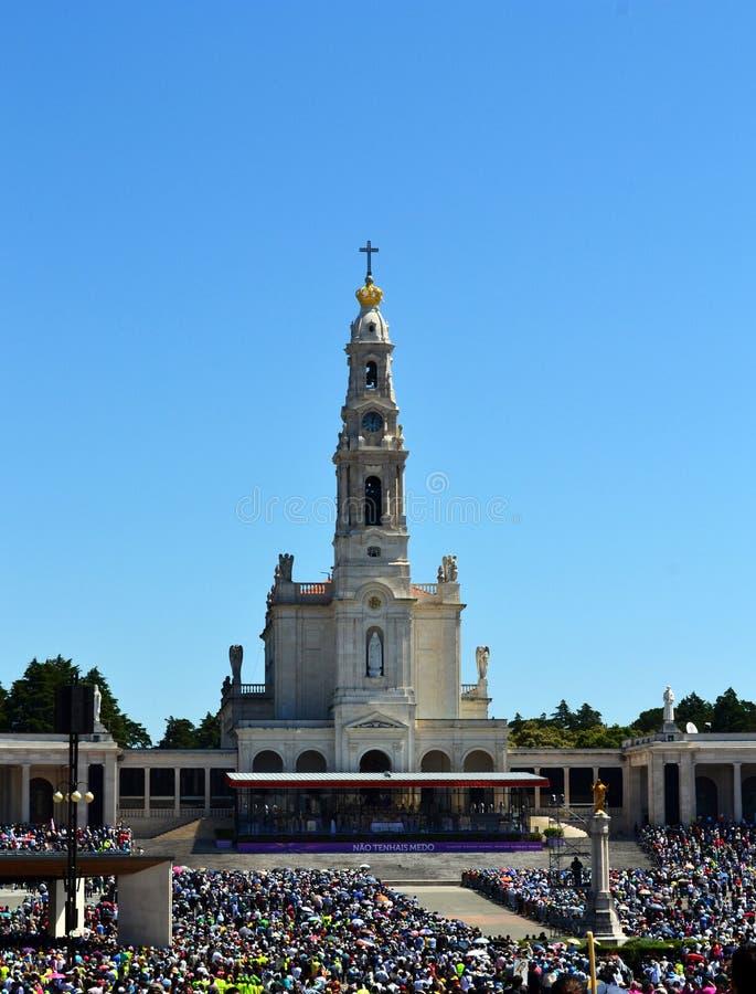 Fatima Sanctuary and pilgrims stock images