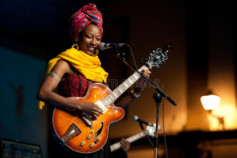 Fatoumata Diawara. CANARY ISLANDS - JULY 8: Fatoumata Diawara is Malian musician, dancer and actor currently living in France, performing onstage during Festival stock image